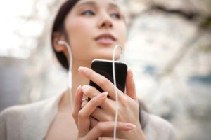 lady listening with ear buds
