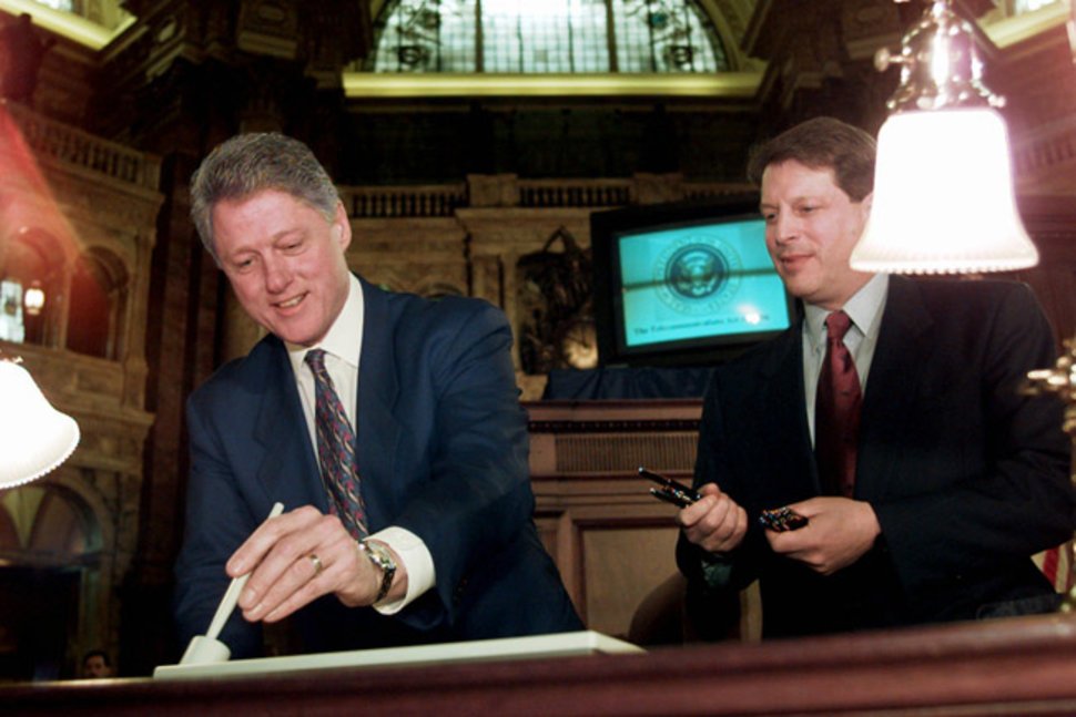 Clinton signs Telcom Act of 1996