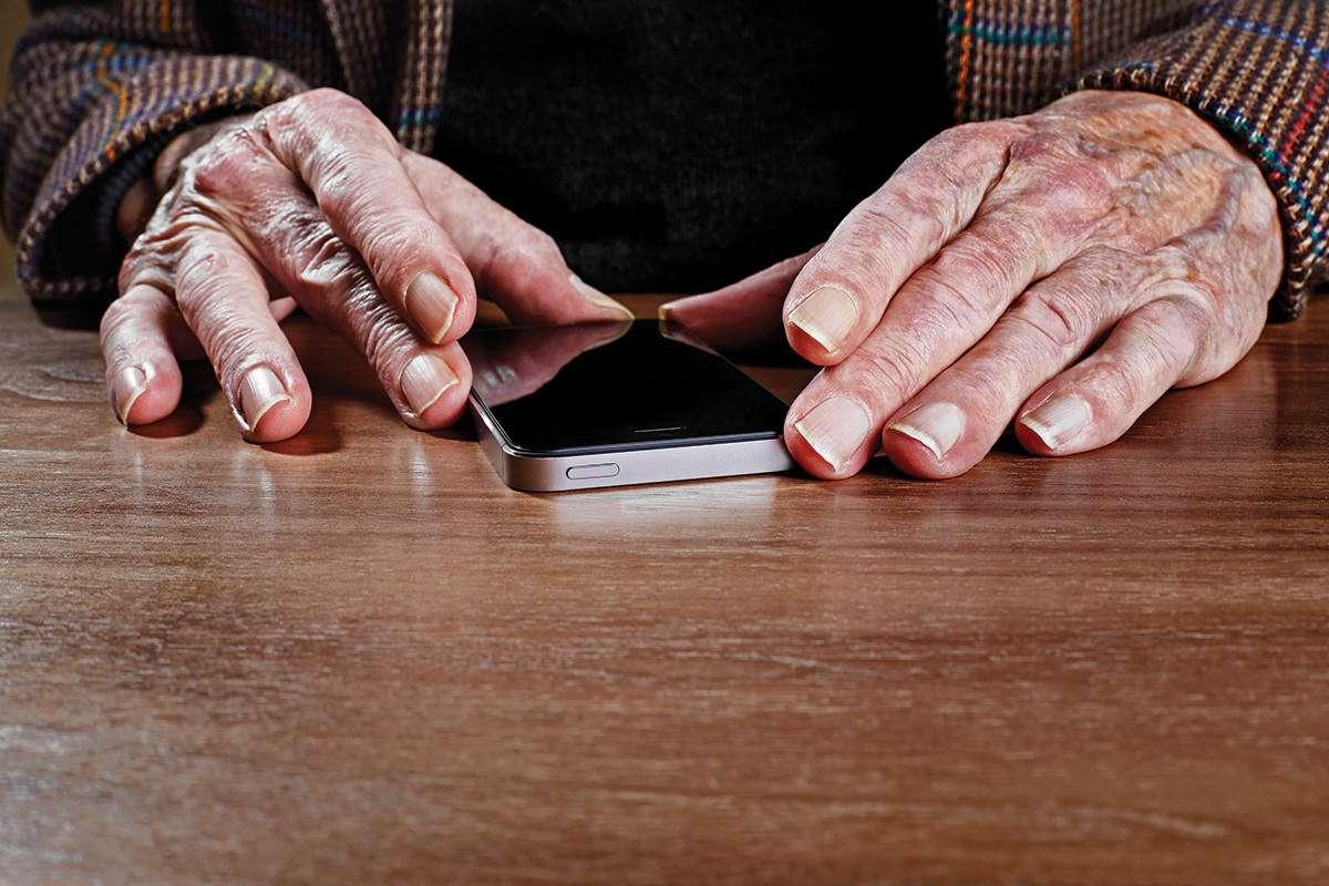 old hands using high tech